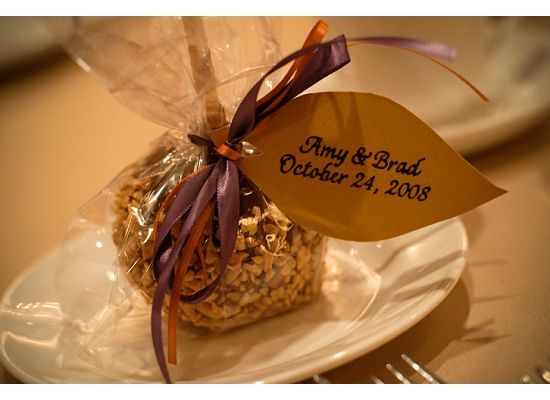 Our carmel apple favors were a big hit and only around $1.20 each!!!   Fall wedding favor ideas.... taffy apple