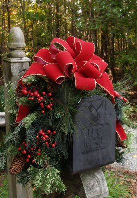 Christmas mailbox decor. Inspiration only. Greenery embellished with berries and a big red ribbon to top it off! Easy to do!