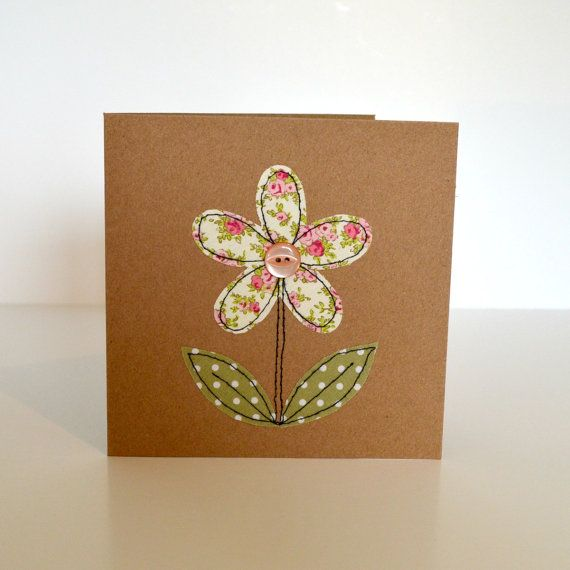 This is a lovely handmade greetings card with a flower design stitched with little pieces of pretty fabric and a button in the centre.  Stitched using freehand machine embroidery.  The card is blank inside so you can write your own special message and comes with a matching envelope.  Card measures approx. 13.5cm x 13.5cm (5.25 x 5.25)  Available in white or brown card, please select.  Everything is lovingly designed and handmade with a lot of care, time and thought and makes a perfect gift…