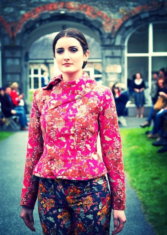 A deep pink liberty print wool jacket and navy liberty print wool trousers, designed by Sinead Doyle