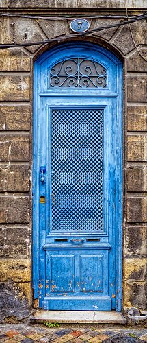 Blue door number 7 in France.