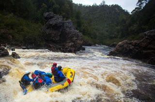 Franklin River, Tasmania Group of people in yellow raft on river