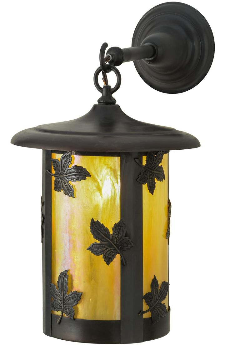 10 Inch W Fulton Maple Leaf Hanging Wall Sconce - 10 Inch W Fulton Maple Leaf Hanging Wall SconceCustom crafted of Solid Brass, this handsome Lantern is designed with Beige Iridescent art glass adorned with stunning maple leaf accents. The cylindricalshaped hardware is finished in Craftsman Brown. this signature Craftsman fixture is listed for both indoorand outdoor applications. Made in America by Meyda artisans. Theme: RUSTIC LODGE ART GLASS Product Family: Fulton Maple Leaf Product Type…