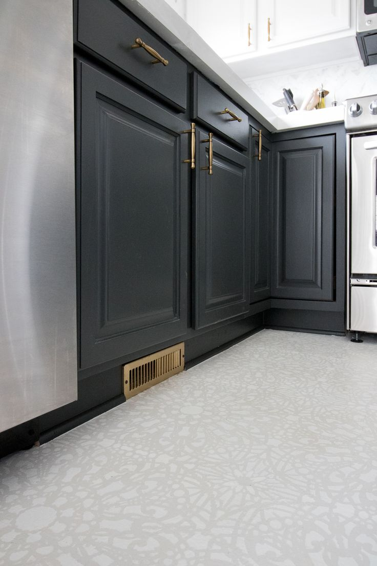 one room challenge kitchen reveal with stenciled floor, DIY white concrete countertops, and calcatta gold marble tile and sherwin williams iron ore painted cabintes lots of kitchen inspiration