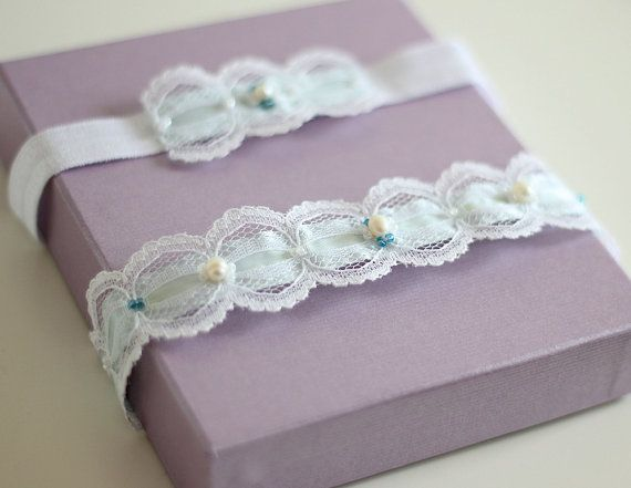 Wedding garters - a set of two vintage lace bridal garters. They have been hand-crafted from a white lace and aqua blue satin ribbon. I used blue