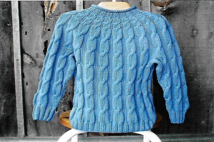 Cabin Fever 208 Knit in the Round Kid's Cable. Uses Double Knitting #3 weight yarn. Sizes 4 years to 8 years.