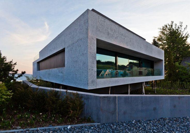 This contemporary concrete house designed by Switzerland-based http://www.อิฐมอญลุงพัน.com