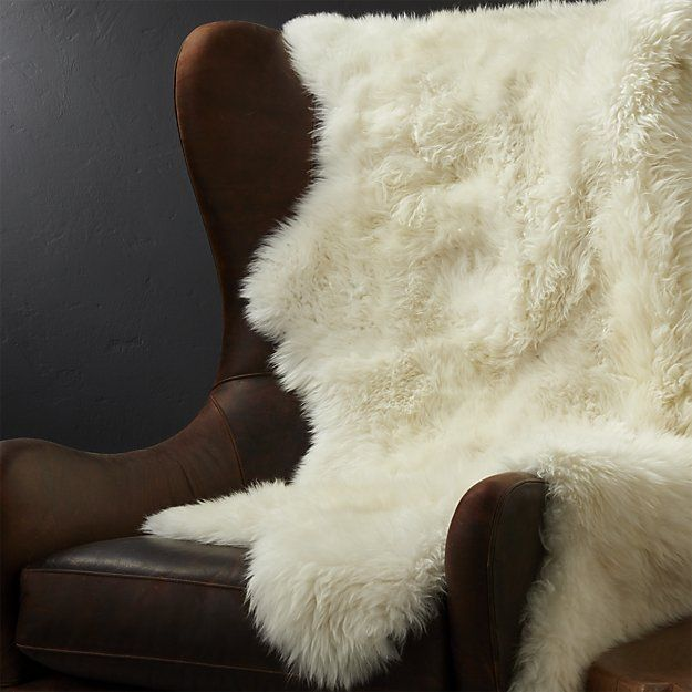 Shop Sheepskin Almond Throw/Rugs.  Winter-ready room accent drapes natural warmth, soft and luxurious, and fleecy textures to the end of the bed, draped over a chair, as an accent rug in low-traffic areas, or as a snug wrap by the fire.