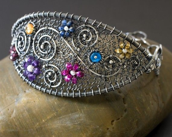 Love the stones and the hand woven wire netting in this bracelet!
