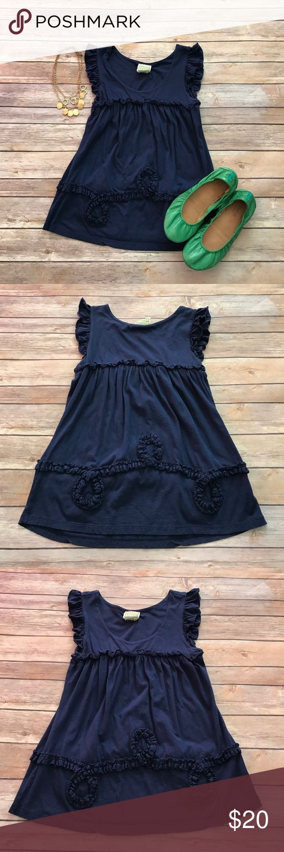 Anthropologie navy tee Anthropologie Little Yellow Button tee in good used condition. There is an almost invisible snag (pictured) near the bottom, but otherwise no flaws. Make an offer or bundle and save! Anthropologie Tops Tees - Short Sleeve