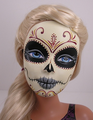 """This is a painted Barbie head I did a couple years ago.  I like to base them off of the Mexican holiday """"Dia de Los muertos""""  which is a celebration of loved ones who have passed.  http://en.wikipedia.org/wiki/Dia_de_los_muertos #dayofthedead"""