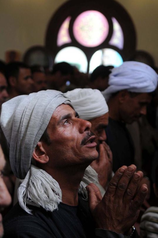 Copts attend a service in the Two Martyrs Church after it was rebuilt by the Egyptian army in April 2011–it was burned down in sectarian clashes the preceding month. (Photographer: Mohammed Hosam - United Press International)