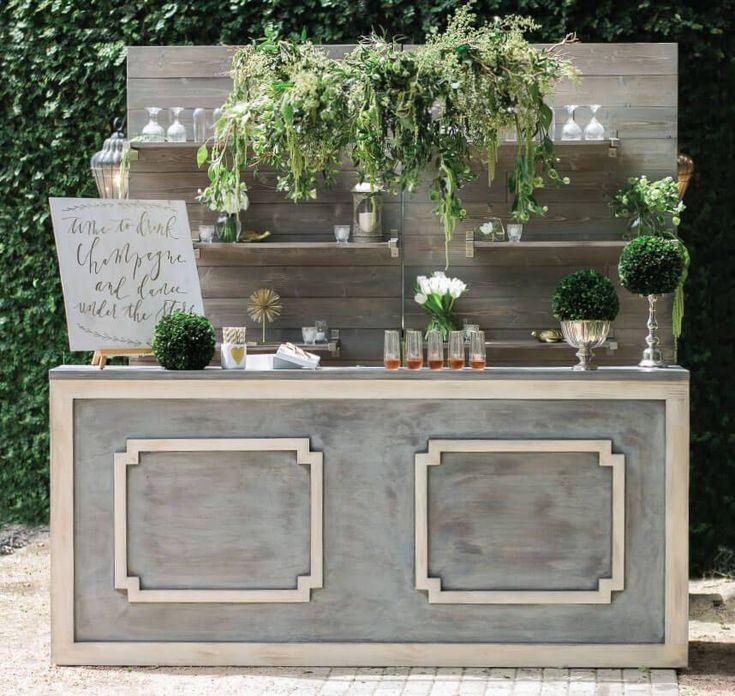 We just love this stylish Al Fresco bar from Marquee Event Group beautifully styled by Pearl Events at Hamilton Twelve. Merveille Events constructed all of the florals, and Wondrous Whimsy created the calligraphy sign. Photos by SMS Photography. #austin #austinwedding #weddingbar #bar #bridesofaustin