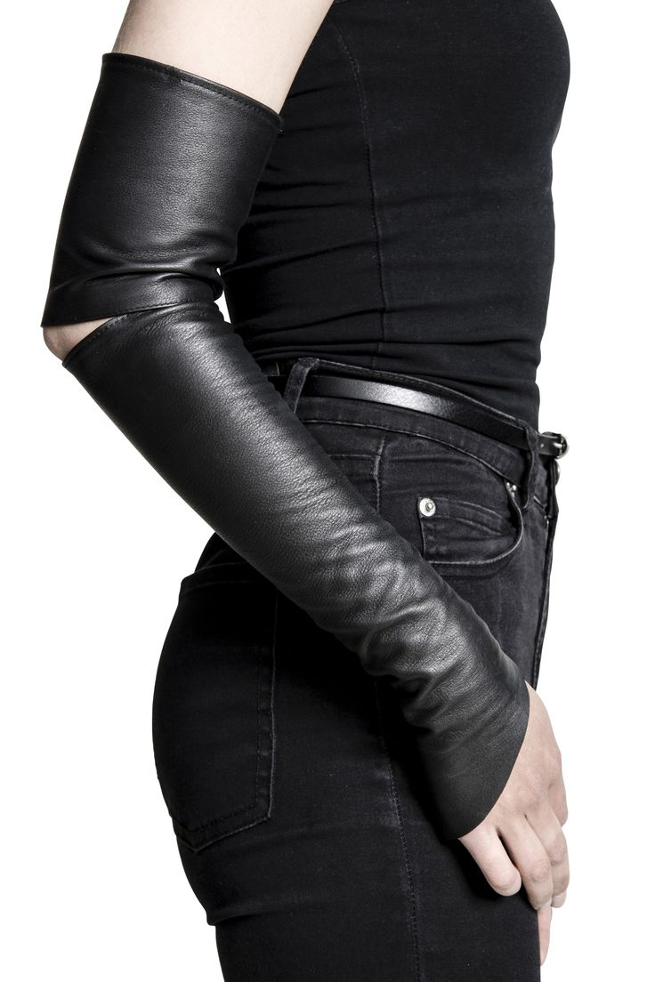 A pair of leather sleeves with cut open elbows.