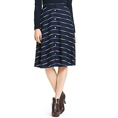 Tommy Hilfiger women's skirt. Light, lovely and languid, our ikat stripe skirt adds feminine whimsy to everything you pair it with. Our favorite part? The way it floats when you walk.<br>• May not be returned or exchanged. <br>• Classic fit. <br>• 100% synthetic.<br>• Side pockets, button front, A-line shape, waist tucks, lined.<br>• Machine washable.<br>• Imported.<br>