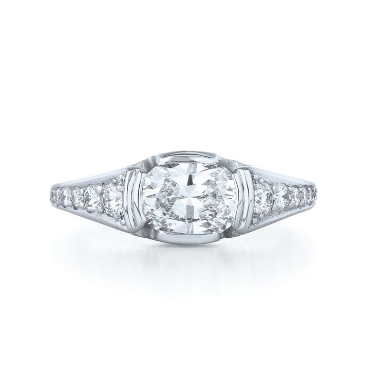 As I mentioned earlier this week, it looks like The Bachelor's Chris Soules picks an engagement ring with an east-west center stone for the girl who gets his final rose. {Whitney or Becca? Becca or Whitney?! } Here's a visual reminder. Engagement Ring 1 This isn't the first time we've seen an east-west engagement ring on The Bachelor; Jason Mesnick presented this east-west Neil Lane ring to Melissa Rycroft, who he proceeded to dump for runner up Molly Malaney. Engagement Ring ...