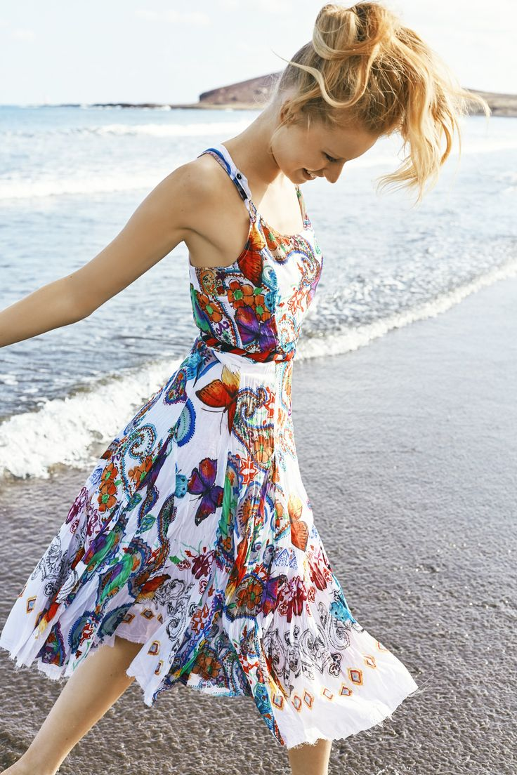 Just because you're at the beach, doesn't mean you can't dress up. This long, fitted sundress with a butterfly and floral print  has an A-line cut and will look just as great at the bar as it will at the beach!