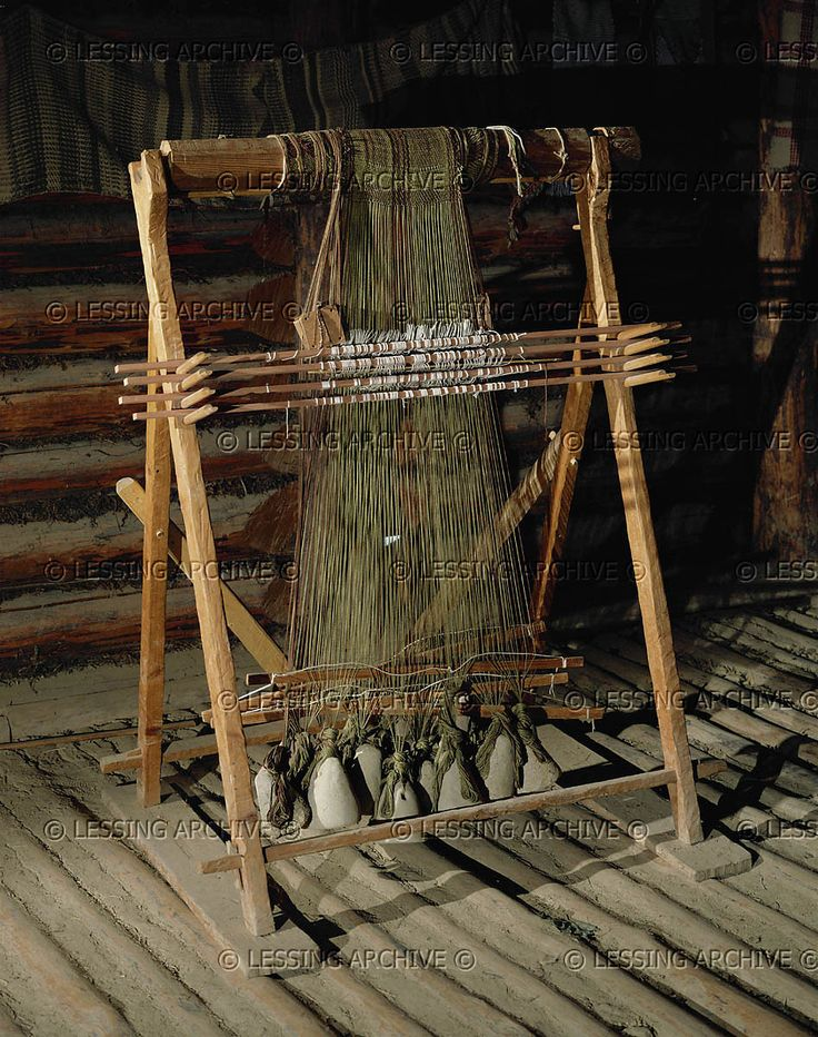 Loom (reconstruction) as used in the 8th to 3rd centuries BCE. Weights are polished stones. Woven and tailored textiles have been found in the Hallstatt saltmine. Museum fuer Vorgeschichte, Asparn/Zaya, Austria