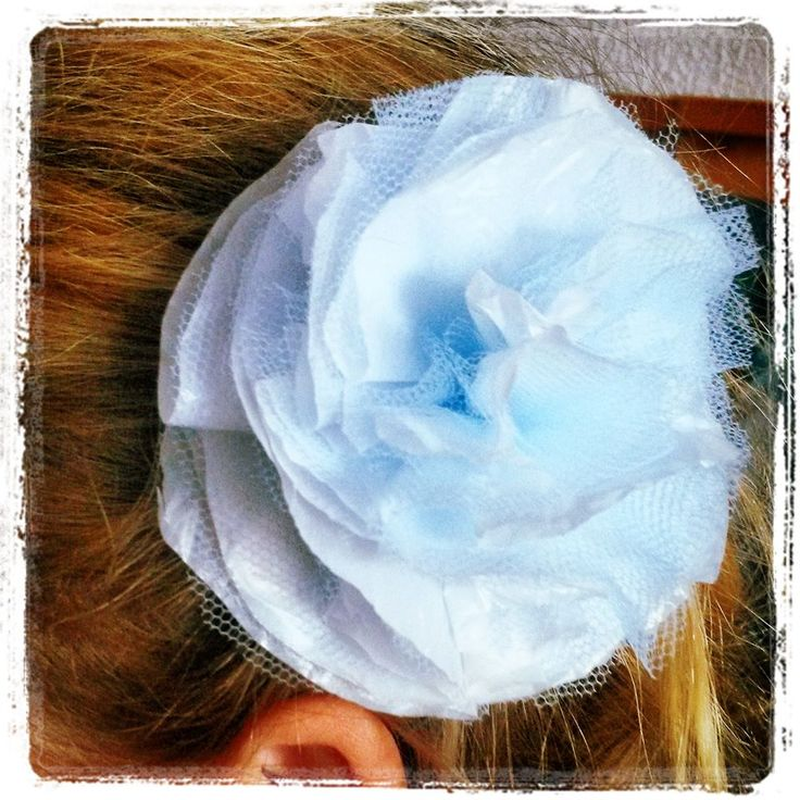 Brooch/hair rosette made from recycled plastic bag and tulle.