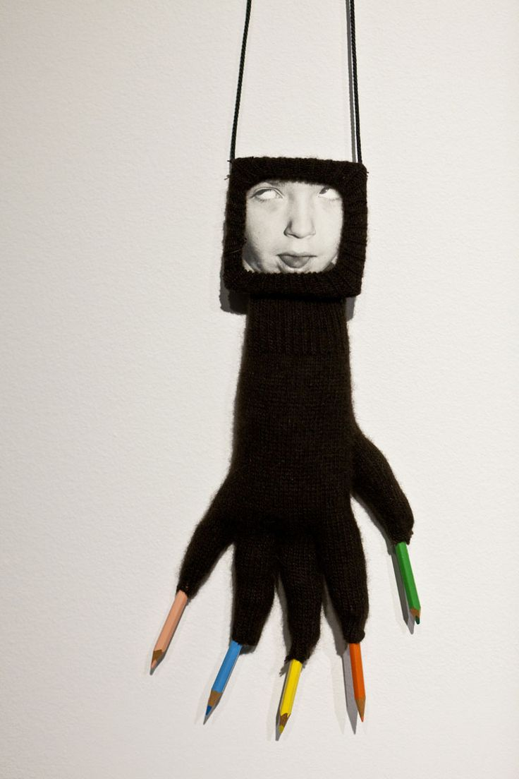Annette Messager, The gloves-Grimaces (detail), 1999 – installation view MCA Australia – glove, framed photography, coloured pencils