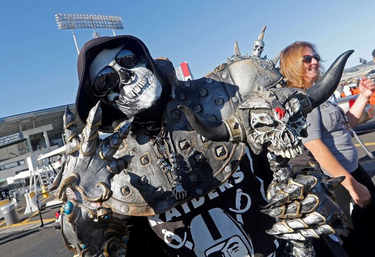 Oakland Raiders -  An Oakland Raiders fan poses for photos in the O.co Coliseum parking lot before an NFL preseason football game between the Oakland Raiders and the St. Louis Rams in Oakland, Calif. on Aug. 14. -  © Tony Avelar/AP Photo