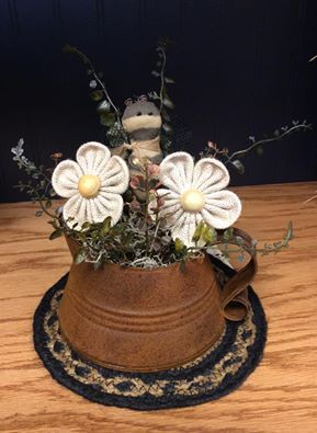 Rustic kettle flower arrangement