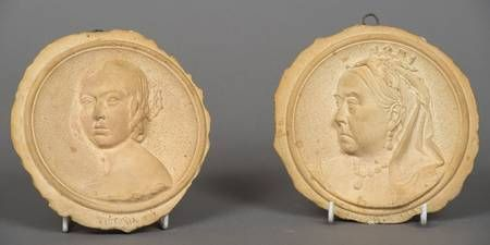A pair of Martin Brothers pottery Royal commemorative plaques Both worked with portraits of Queen Victoria, one dated 1837, the other 1897, both titled and signed R W Martin SC to recto and further signed to verso R W Martin SC Southall and dated 3.XI.98 and 10-1898
