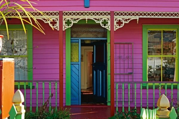 """The colour scheme for Doris de Pont and Tejo van Schie's Grey Lynn villa was controversial at first, says Doris; their son Micky even """"screenprinted a T-shirt with the slogan: 'I do not live in a pink house'""""; but when it was time to repaint, their now grown-up children insisted it should be redone in the same hues, carefully colour-matched."""