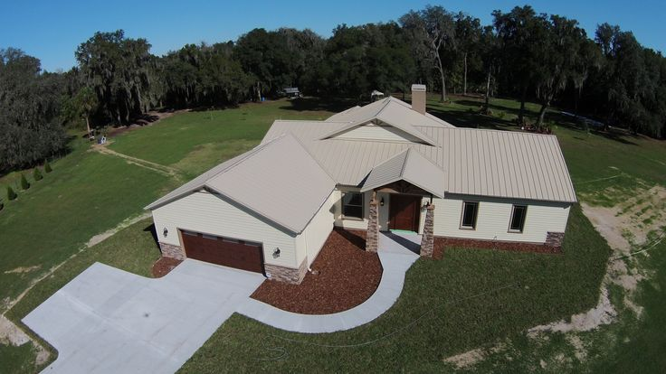 "Residential Metal Install in Lithia Florida - This custom built home is complimented with a metal roof installed by Garrett Roofing, Inc.  The homeowner was impressed with the look of the new roof. var cpm_language = ""lng"":""en"";var cpm_global = cpm_global 