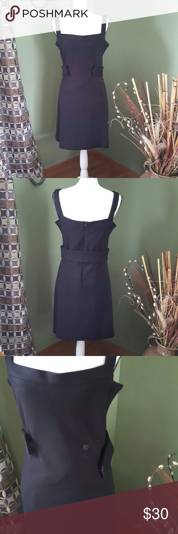 Black jumper style dress Completely lined jumper dress is a mix of wool, acrylic, spandex and nylon.  Zippered in back with detachable belt. Never worn MODA International is one of victorias secrets past clothing lines. Moda International Dresses
