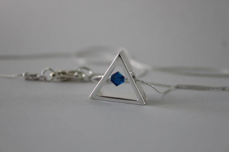 silver triangle frames beautiful blue crystal at http://www.etsy.com/shop/ArgyleSugar