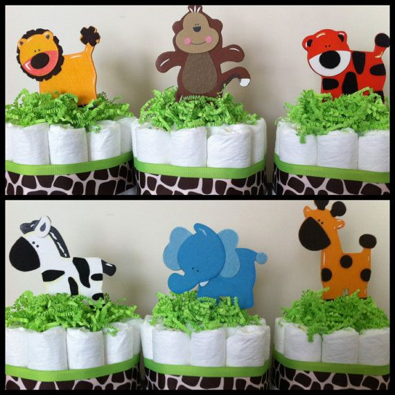 I think I could make these.    Mini Jungle Diaper Cakes SET OF 6, Safari Baby Shower, Baby Shower Centerpiece,Gender Neutral Baby Shower, Gender Neutral Diaper Cakes