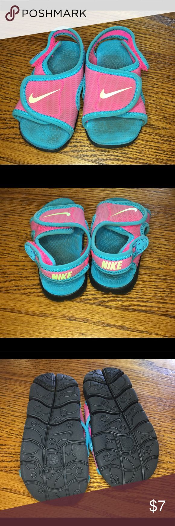 Size 4 Nike Water shoes Nike water shoes just in time for summer. The double Velcro is perfect for those wiggly toddlers, just slap me on and go Nike Shoes Water Shoes