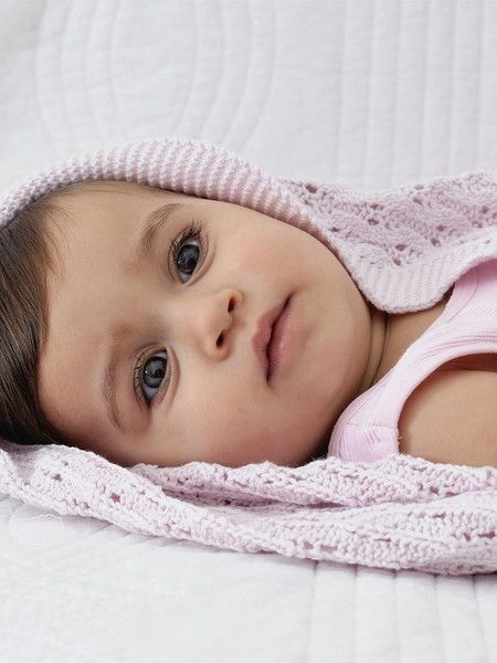 Designed in Australia with its delicate lattice knit pattern in a blush of pink, this is a gift to be treasured by multiple generations.  Pure cotton ensures easy care and durability, and at a size of 100 x 80cm it's the perfect size for an heirloom Christening shawl or special occasion blanket.  This Little Bonbon baby shawl is presented in a beautiful gift tube.