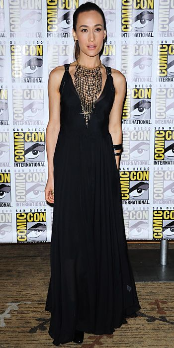 MAGGIE Q Divergent star Q promoted the movie at Comic-Con in an extravagant necklace bib and a black maxi dress.