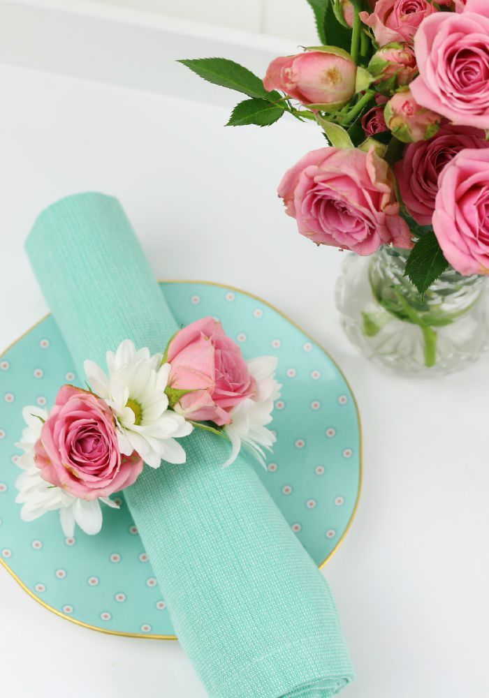 DIY – Flower Napkin Rings.  Use fresh flowers to create a pretty floral napkin ring for your table setting.  Click for full tutorial.