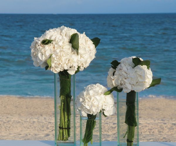 White hydrangea floral arrangements for beach wedding | Nautical Collection at Palace Resorts #destinationwedding