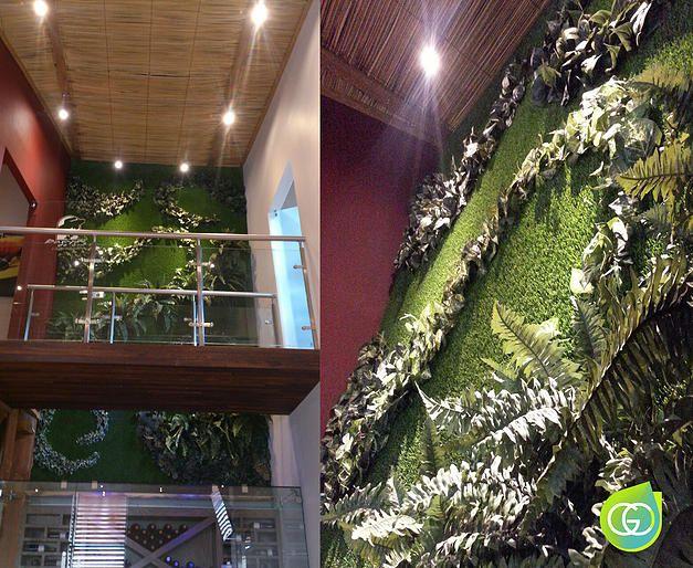 Muro verde en interiores pasto sintetico y plantas for Plantas artificiales para interiores