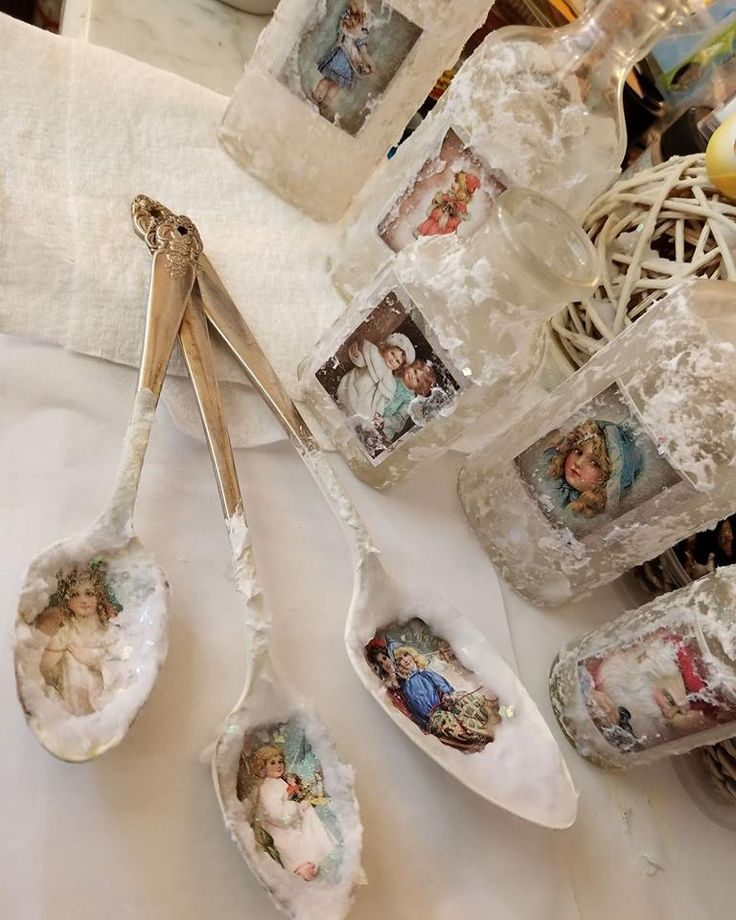 Vintage spoons painted with Buttercream, decorated with Victorian angel images, snow, German glass glitter, and fine glitter. By: Claire Matthew #dixiebellepaint #bestpaintonplanetearth #chalklife #homedecor #doityourself #diy #chalkmineralpaint #chalkpainted #easypeasypaint #makingoldnew #whybuynew #justpainting