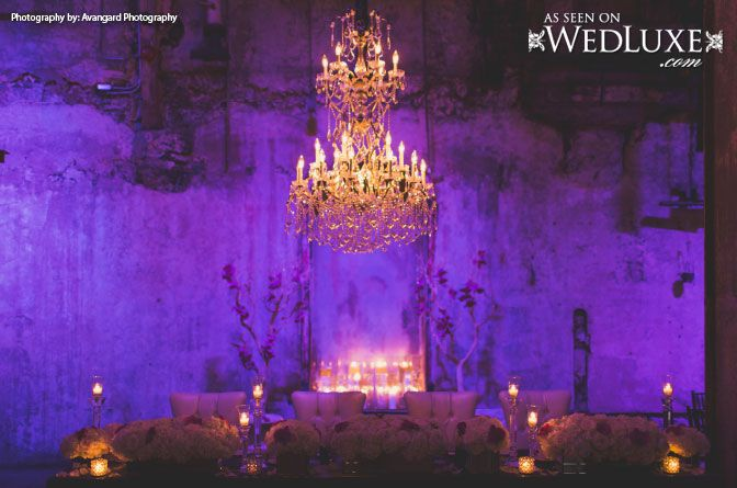 WedLuxe: purple lighting and a stunning chandelier took center stage at this pretty #wedding