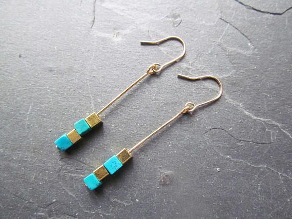 Dainty turquoise earrings made with square teal and gold beads floating on a metal bar in a modern minimalist design with a boho touch. This necklace is perfect for those who love minimalist designs and for those who love colorful jewelry. Material: brass. square brass beads square teal