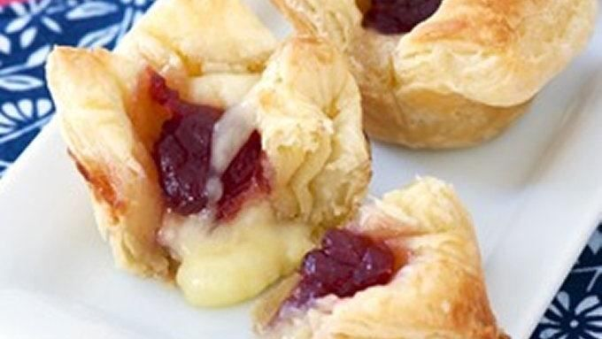 Cranberry sauce, brie, and frozen puff pastry are all you need to make this tasty appetizer! Simple and quick, these little bites of deliciousness from Tablespoon.com are great for any parties.