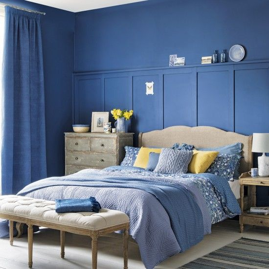 Team a deep indigo blue with purplish cornflower blues, adding textured woods and plenty of soft textiles for a comfortable, lived-in look. Dark blues are heavy, so this room has been lightened up with touches of yellow and cream
