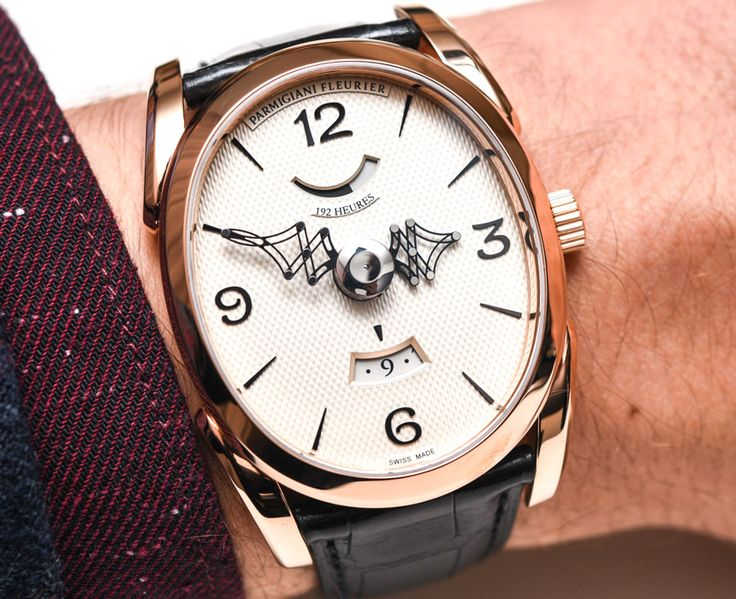 Hands-On with the Parmigiani Ovale Pantographe 'Guilloche' Barley Grain Dial & Gold Movement with the awesome system of telescopic hands which uses more than 30 parts in mostly titanium to display the time...  Read all about it: http://www.ablogtowatch.com/parmigiani-ovale-pantographe-guilloche-barley-grain-dial-gold-movement-watch/