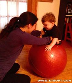 how to encourage ababy with hypertonia sit
