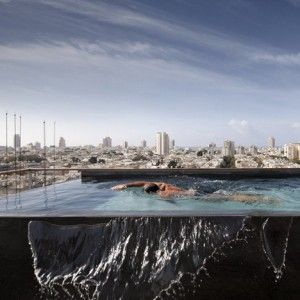 Tel Aviv Penthouse by Pitsou Kedem features  an infinity pool overlooking the city