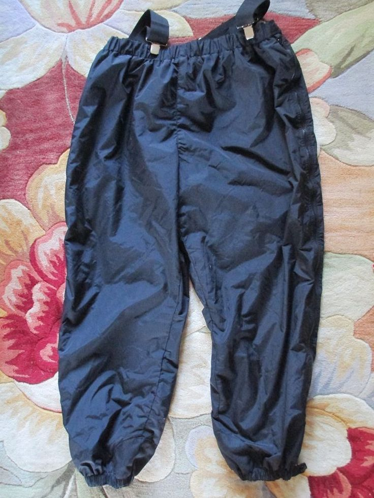 "Men's size 4 XL with removable suspenders. Columbia Sportswear Snowboard Pants. The inseam is 33"" and the rise is about 19"". W aist measures 44"" unstretched and has elastic all the way around with velcro tabs. 
