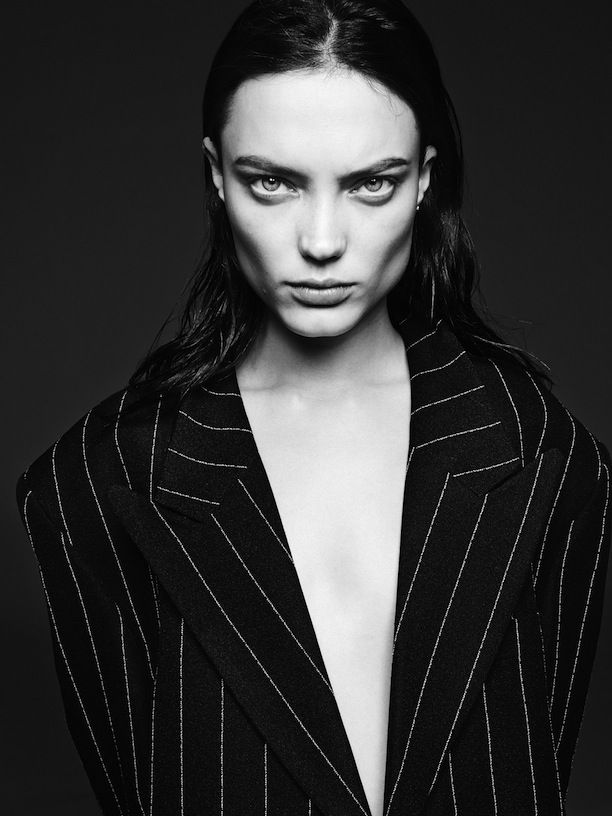 Sleek, center-parted hair on model Naty Chabanenko