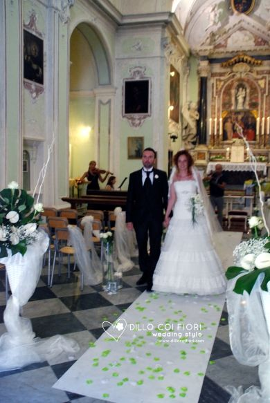 the bride and groom in the aisle ready to quit