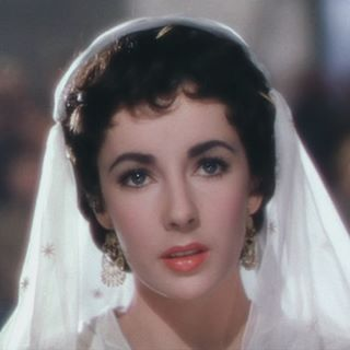 """ELIZABETH TAYLOR in """"Ivanhoe"""" (1952). This film also starring Robert Taylor, Joan Fontaine and George Sanders, was one of the highest grossing films of 1952"""